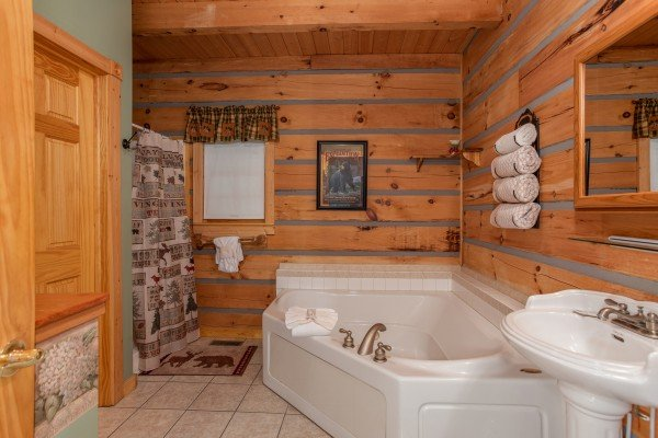 Jacuzzi tub in a bathroom at Stream On! A 2 bedroom cabin rental located in Pigeon Forge