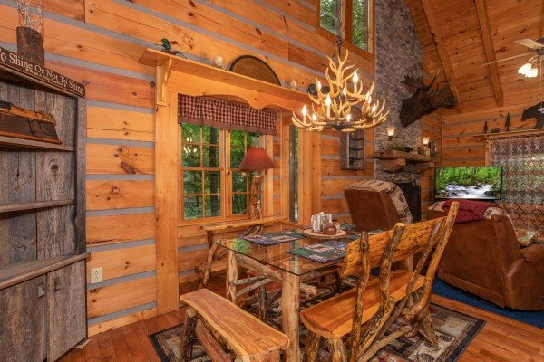 Dining table for four at Stream On! A 2 bedroom cabin rental located in Pigeon Forge