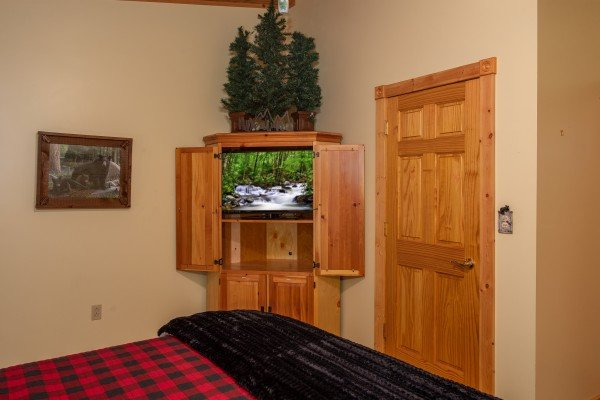 TV in an armoire at Stream On! A 2 bedroom cabin rental located in Pigeon Forge