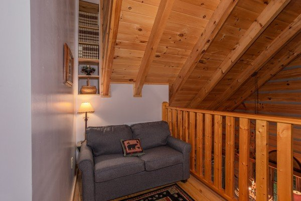 Loveseat in the loft at Stream On! A 2 bedroom cabin rental located in Pigeon Forge