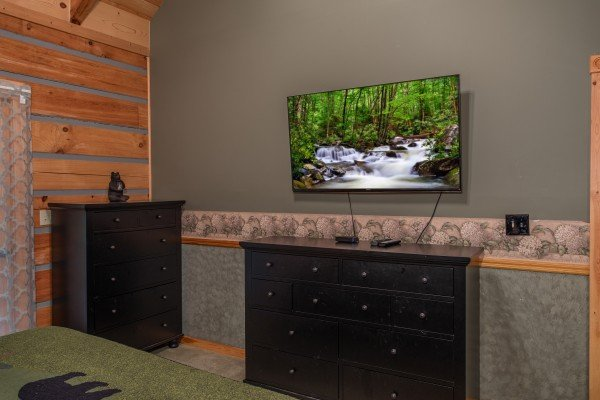 Dressers and a TV in the bedroom at Stream On! A 2 bedroom cabin rental located in Pigeon Forge