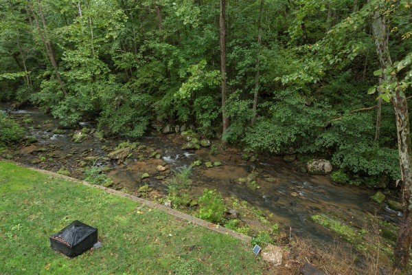 Stream from the deck at Stream On! A 2 bedroom cabin rental located in Pigeon Forge