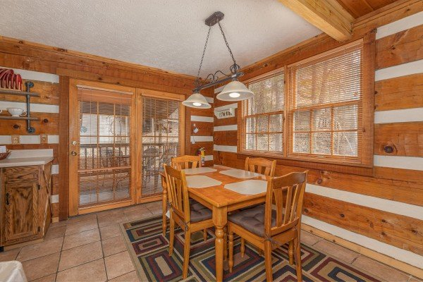 Dining table for four at Wild at Heart, a 1 bedroom cabin rental located in Gatlinburg