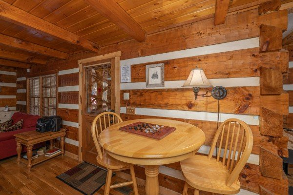 Dining table for two and a checkers game at Wild at Heart, a 1 bedroom cabin rental located in Gatlinburg
