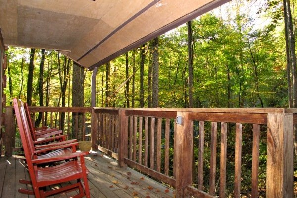 Front covered porch with rocking chairs at Wild at Heart, a 1 bedroom cabin rental located in Gatlinburg