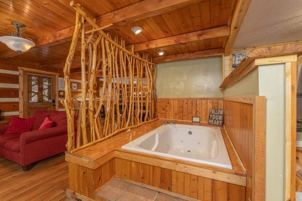 Jacuzzi in the living room at Wild at Heart, a 1 bedroom cabin rental located in Gatlinburg