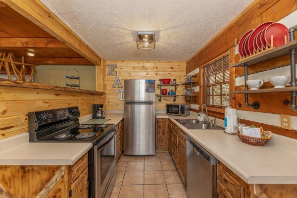 Kitchen with stainless appliances at Wild at Heart, a 1 bedroom cabin rental located in Gatlinburg