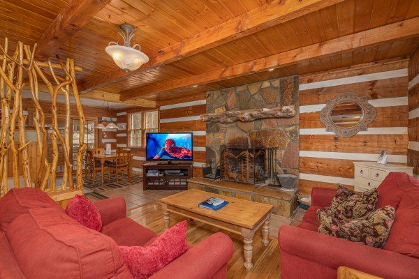 Living room with fireplace and TV at Wild at Heart, a 1 bedroom cabin rental located in Gatlinburg