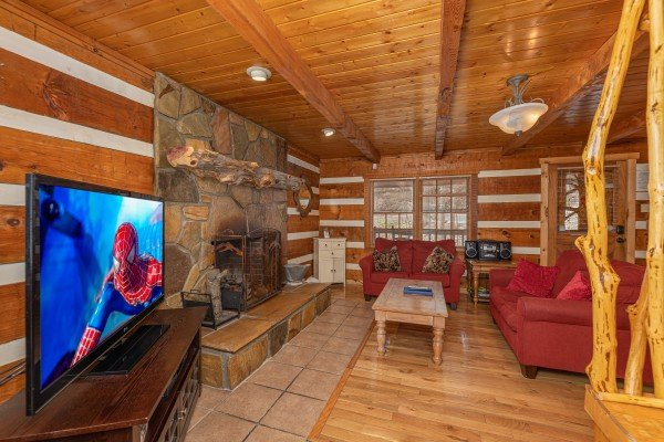 Living room with TV and fireplace at Wild at Heart, a 1 bedroom cabin rental located in Gatlinburg