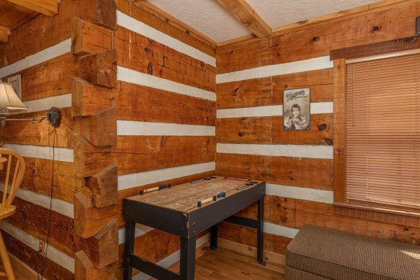 Shuffleboard game at Wild at Heart, a 1 bedroom cabin rental located in Gatlinburg