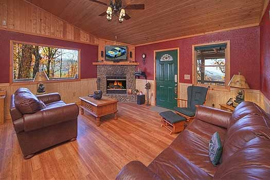 living room with fireplace at a finders keepers a 3 bedroom cabin rental located in pigeon forge