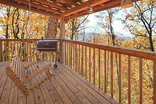 swing on deck alongside grill at a finders keepers a 3 bedroom cabin rental located in pigeon forge