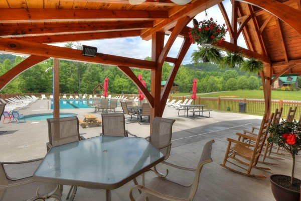 Resort pool area at Friends in High Places, a 4-bedroom cabin rental located in Pigeon Forge