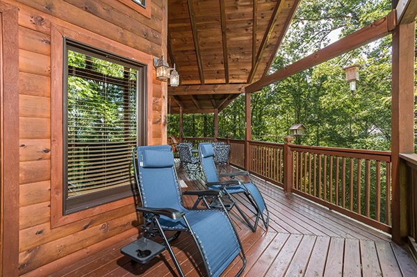 Reclining chairs on the deck at Friends in High Places, a 4-bedroom cabin rental located in Pigeon Forge