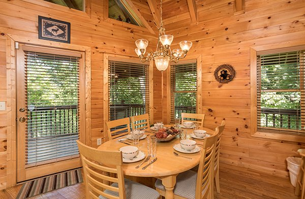 Dining table with seating for six at Friends in High Places, a 4-bedroom cabin rental located in Pigeon Forge