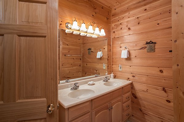 Double vanity sinks in a bathroom at Friends in High Places, a 4-bedroom cabin rental located in Pigeon Forge