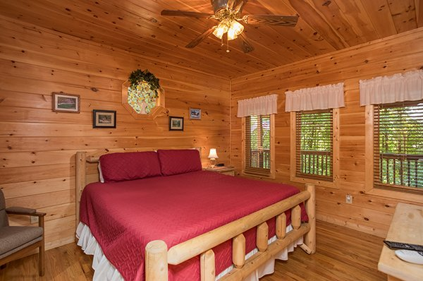 Bedroom with a king-sized bed at Friends in High Places, a 4-bedroom cabin rental located in Pigeon Forge