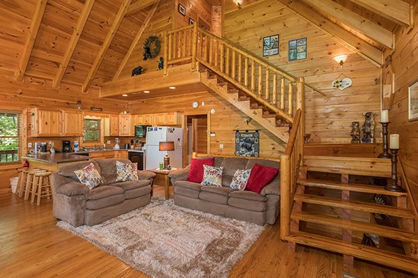 Living room with a sofa and loveseat at Friends in High Places, a 4-bedroom cabin rental located in Pigeon Forge