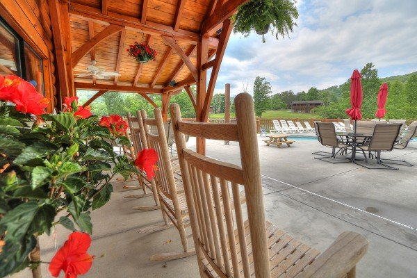 Rocking chairs near the resort pool at Friends in High Places, a 4-bedroom cabin rental located in Pigeon Forge