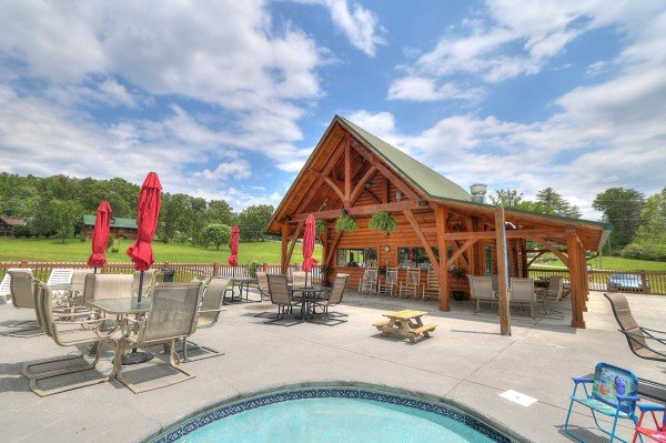 Clubhouse and patio furniture at the resort pool at Friends in High Places, a 4-bedroom cabin rental located in Pigeon Forge