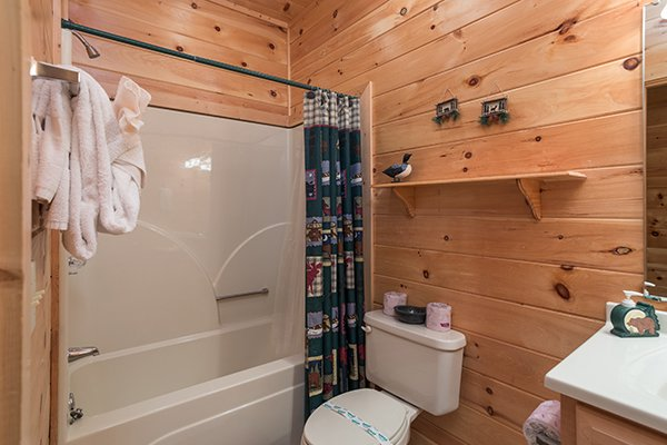 Bathroom with a tub and shower at Friends in High Places, a 4-bedroom cabin rental located in Pigeon Forge