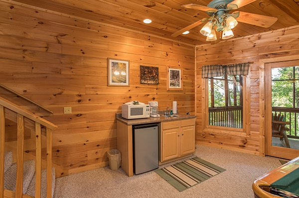 Wet bar with a microwave and drink chiller at Friends in High Places, a 4-bedroom cabin rental located in Pigeon Forge