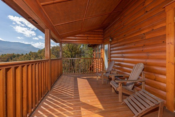 Covered deck with mountain views at Sensational Views, a 3 bedroom cabin rental located in Gatlinburg