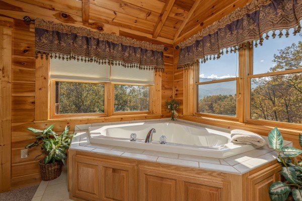Jacuzzi in the loft at Sensational Views, a 3 bedroom cabin rental located in Gatlinburg