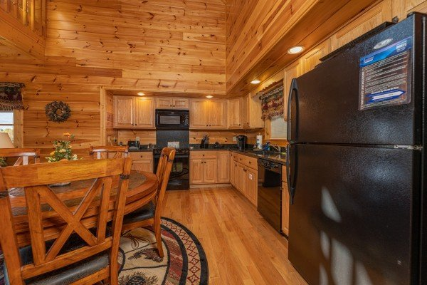 Kitchen and dining table at Sensational Views, a 3 bedroom cabin rental located in Gatlinburg