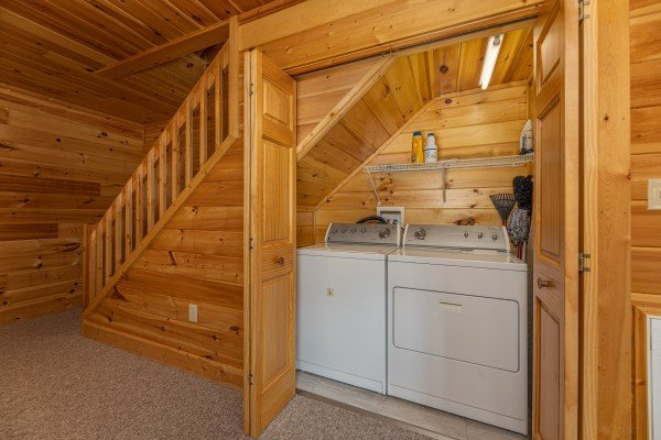 Laundry space under the stairs at Sensational Views, a 3 bedroom cabin rental located in Gatlinburg