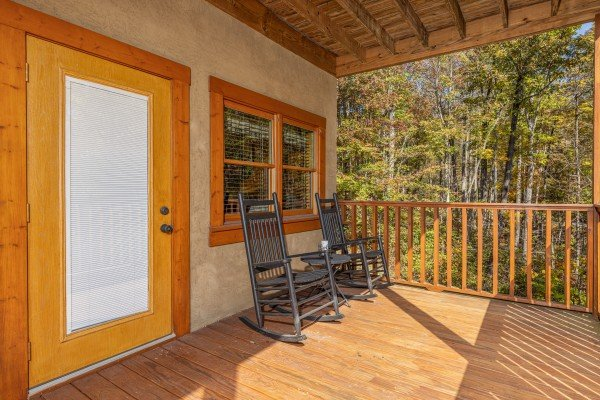 Deck with two rocking chairs at Sensational Views, a 3 bedroom cabin rental located in Gatlinburg