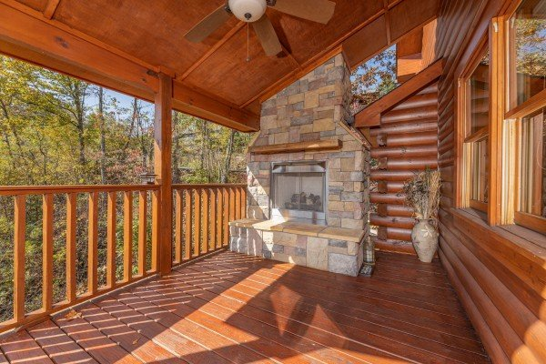 Fireplace on the deck at Sensational Views, a 3 bedroom cabin rental located in Gatlinburg