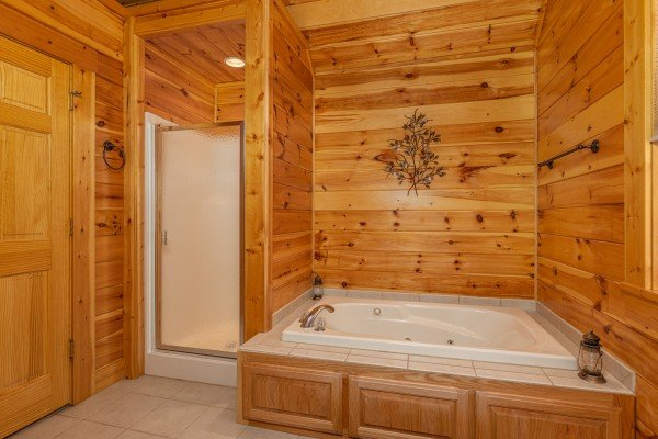 Bathroom with a shower stall and a jacuzzi tub at Sensational Views, a 3 bedroom cabin rental located in Gatlinburg