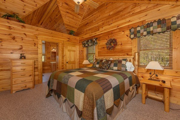 Bedroom with dresser, two night stands, and lamps at Sensational Views, a 3 bedroom cabin rental located in Gatlinburg