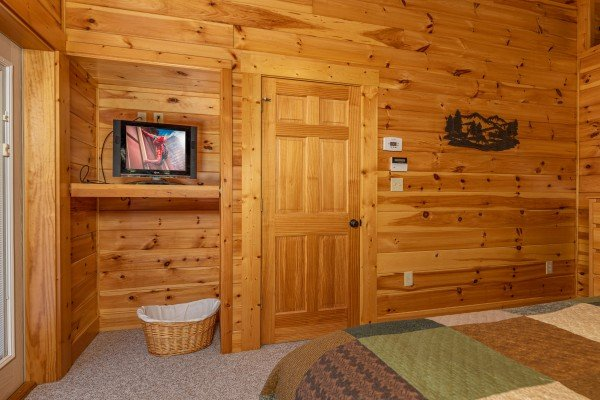 TV in a bedroom at Sensational Views, a 3 bedroom cabin rental located in Gatlinburg