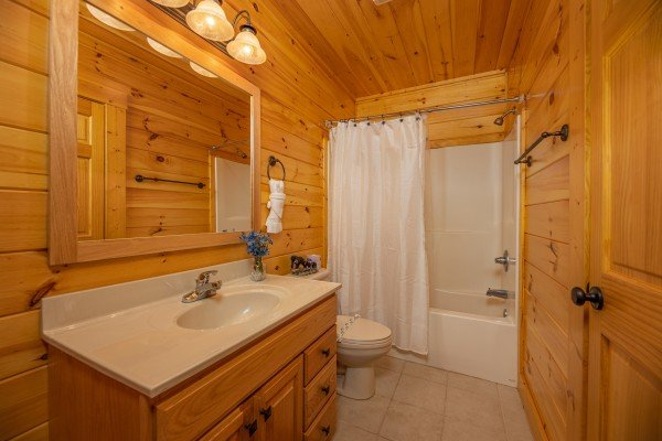 Bathroom with a tub and shower at Sensational Views, a 3 bedroom cabin rental located in Gatlinburg