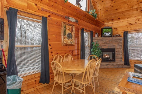 Dining set for six at Smoky Mountain Mist, a 3 bedroom cabin rental located in Gatlinburg