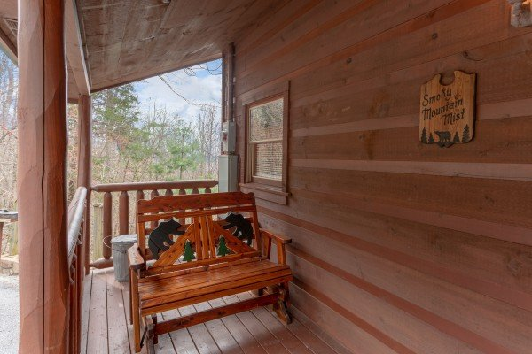 Bear gliding rocker on the front porch at Smoky Mountain Mist, a 3 bedroom cabin rental located in Gatlinburg