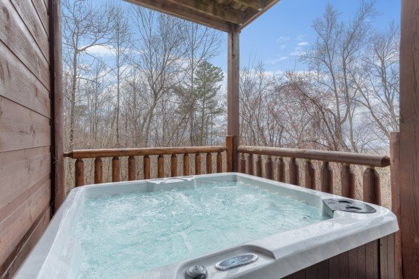 Hot tub on the covered deck at Smoky Mountain Mist, a 3 bedroom cabin rental located in Gatlinburg