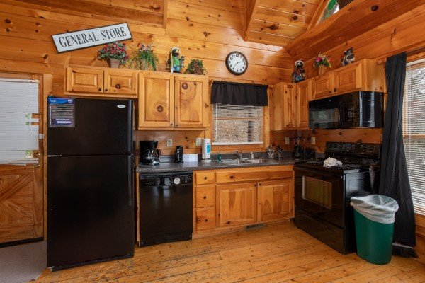 Kitchen with black appliances at Smoky Mountain Mist, a 3 bedroom cabin rental located in Gatlinburg
