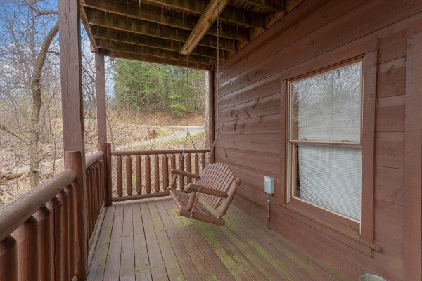 Porch swing at Smoky Mountain Mist, a 3 bedroom cabin rental located in Gatlinburg