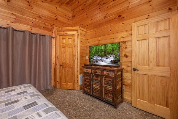 Dresser and TV in a bedroom at La Dolce Vita, a 4 bedroom cabin rental located in Gatlinburg