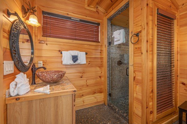 Vanity and shower in a bedroom at La Dolce Vita, a 4 bedroom cabin rental located in Gatlinburg