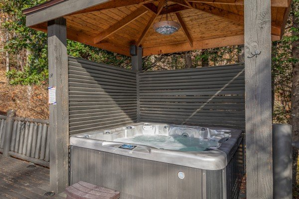 Hot tub with a covered surround at La Dolce Vita, a 4 bedroom cabin rental located in Gatlinburg