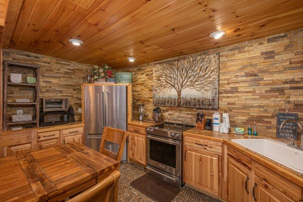 Kitchen with stainless appliances at La Dolce Vita, a 4 bedroom cabin rental located in Gatlinburg
