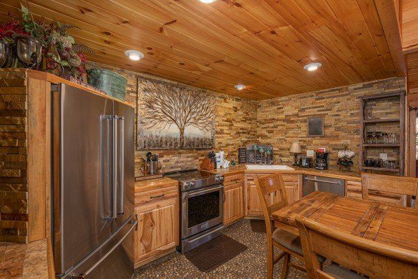 Kitchen and dining space at La Dolce Vita, a 4 bedroom cabin rental located in Gatlinburg