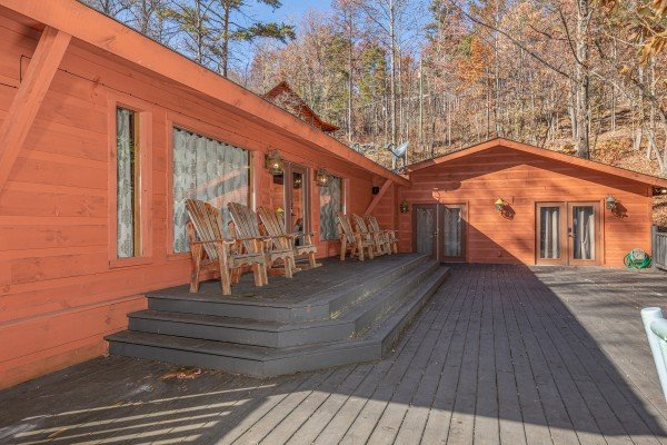 Deck with Adirondack chairs at La Dolce Vita, a 4 bedroom cabin rental located in Gatlinburg