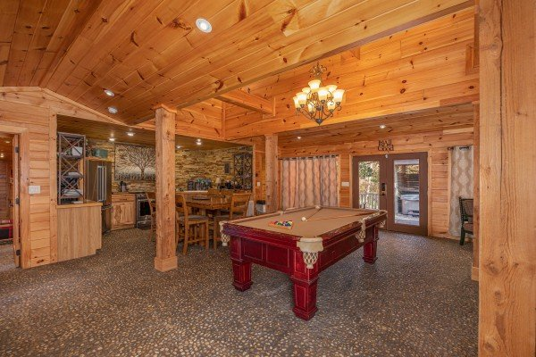 Pool table in the main room at La Dolce Vita, a 4 bedroom cabin rental located in Gatlinburg