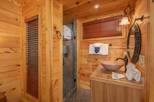 Stone shower and bathroom vanity in a bedroom at La Dolce Vita, a 4 bedroom cabin rental located in Gatlinburg