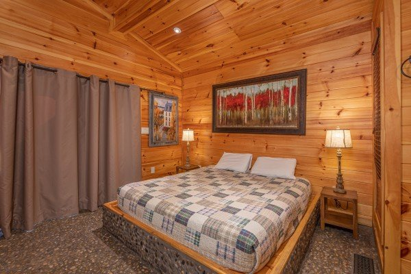 Bedroom with a king bed, two night stands and lamps at La Dolce Vita, a 4 bedroom cabin rental located in Gatlinburg